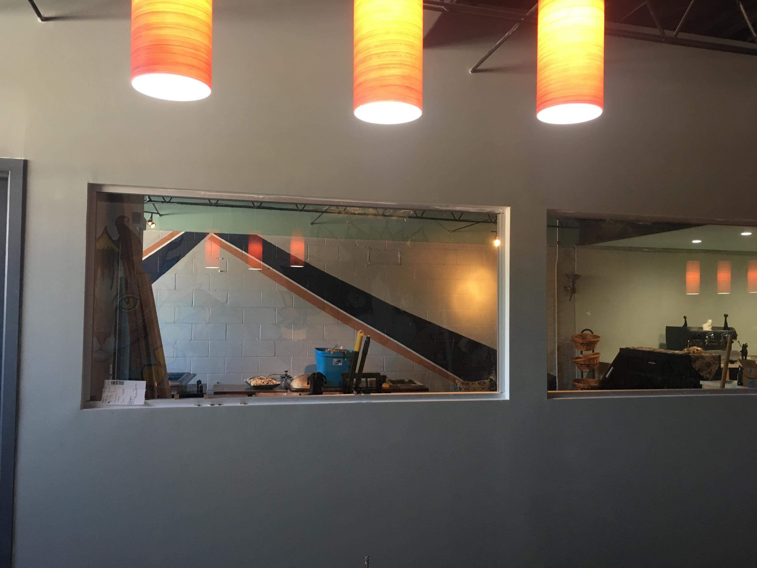 Patrons can sit at bar and look into cat lounge.