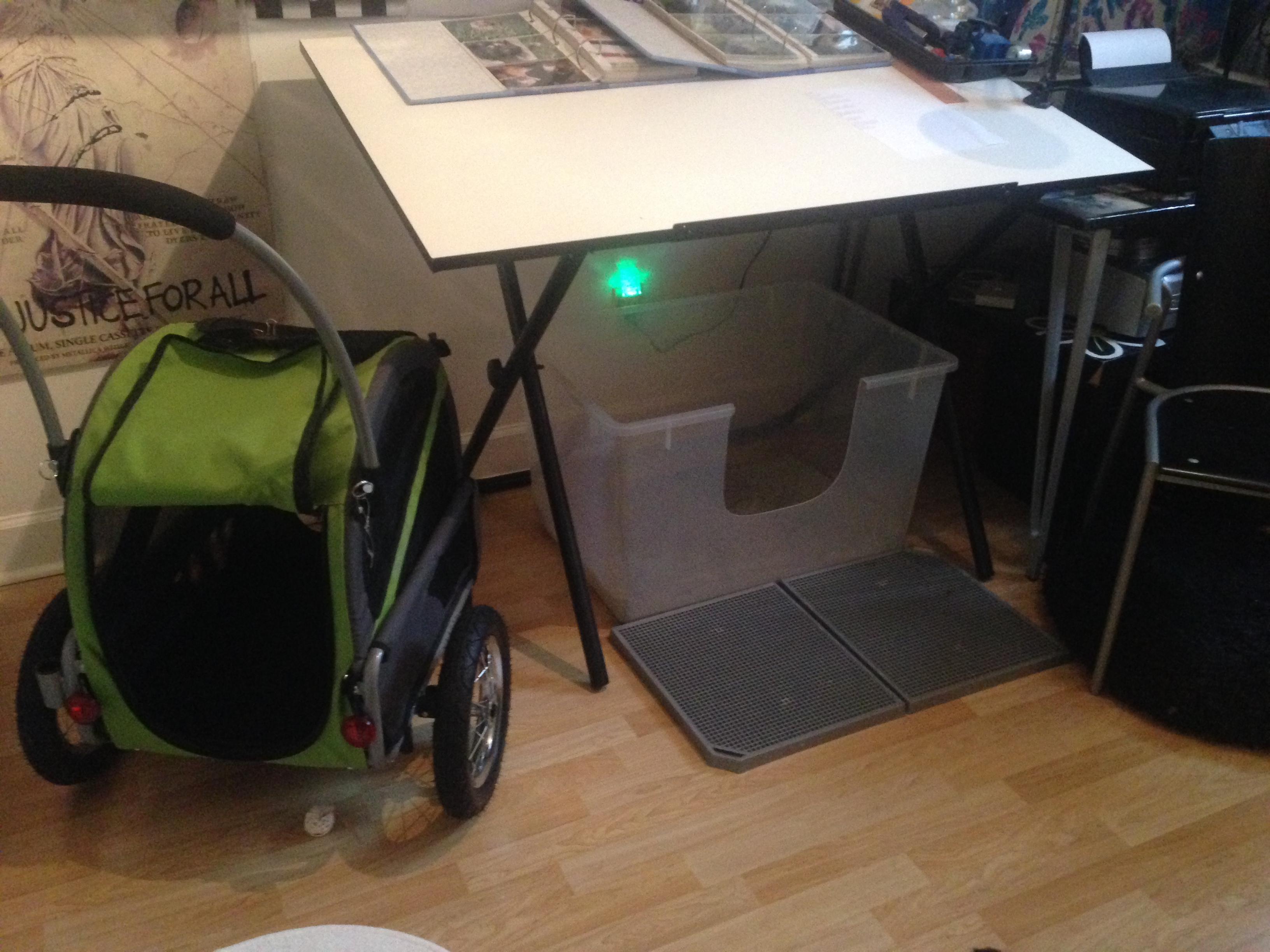 """Under the drafting table in our """"studio."""" (home office)"""